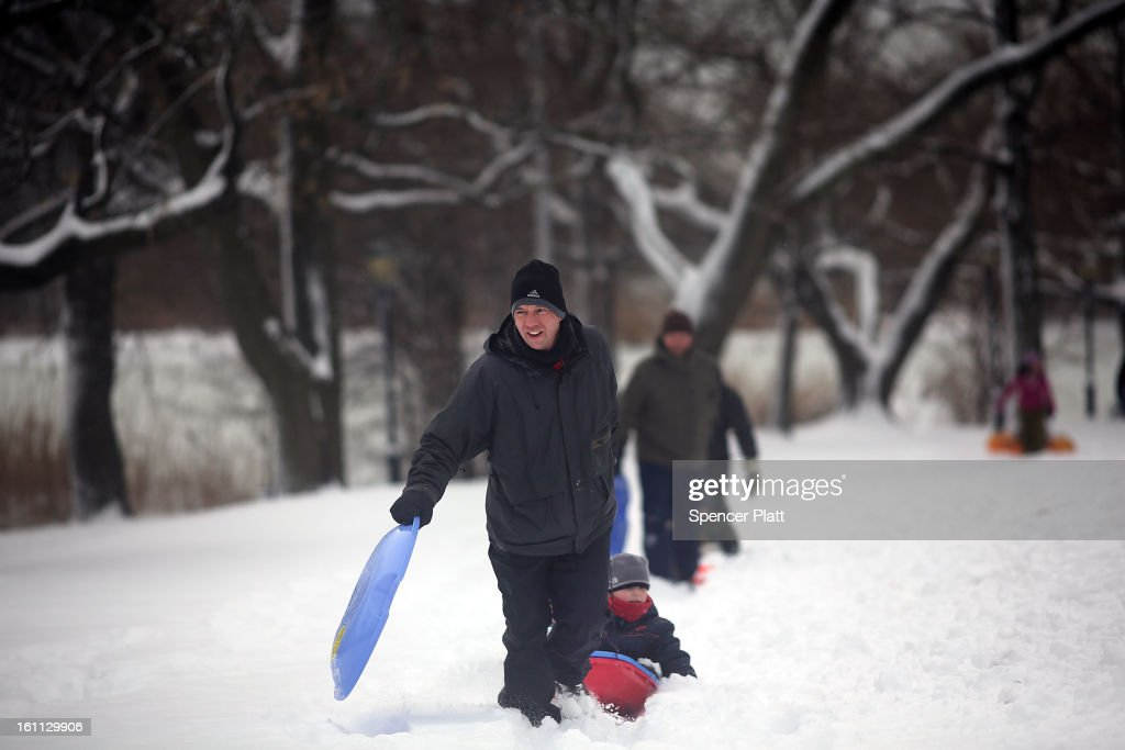 A man pulls a child on a sled in Prospect Park in Brooklyn the morning after a massive snow storm on February 9, 2013 in New York City. New Yorkers woke up to over 10 inches of snow Saturday morning while parts of New England received over thirty inches following a storm that brought high winds and blizzard like conditions to the region.