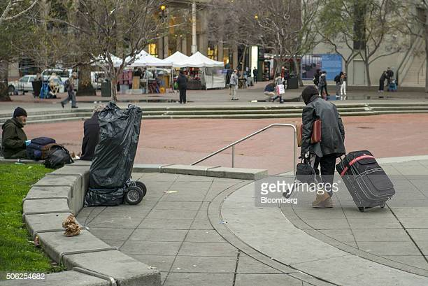 A man pulls a suitcase as he walks in Justin Herman Plaza in San Francisco California US on Thursday Jan 21 2016 San Francisco host city for the...