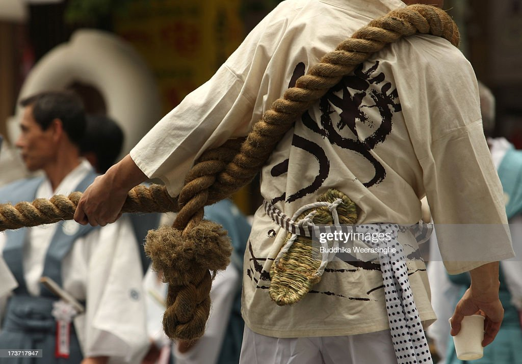 A man pulls float named Yamahoko during the annual Kyoto Gion Festival on July 17, 2013 in Kyoto, Japan. The Gion festival is one of three biggest Japanese festivals. dating back to the 9th century, the festival is part of a ritual intended to satisfy the Gods that brought on fire, floods and earthquakes. During the festival the streets are decorated with lanterns and many of the women dress in 'yukata', summer kimonos.