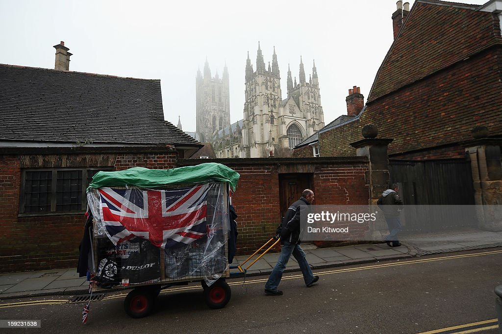 A man pulls his cart past Canterbury Cathedral ahead of the election of Justin Welby as the new Archbishop of Canterbury, on January 10, 2013 in Canterbury, England. The College of Canons met today inside the 14th century Chapter House at Canterbury Cathedral to elect the new Archbishop after receiving the 'Conge d' Elire' and 'Letter Missive' from the Crown authorising the election to take place. Welby, currently the Bishop of Durham, will take over from Dr Rowan Williams, the 104th Archbishop of Canterbury, who stepped down from the position on December 31, 2012.