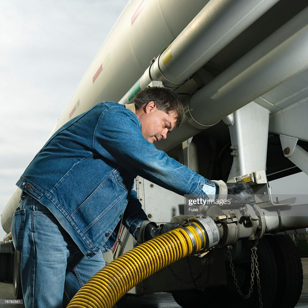 Man Pumping Fuel from a Fuel Truck