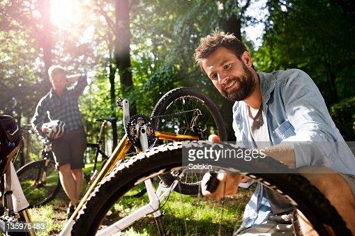 Man pumping moutainbike tire : Stock Photo