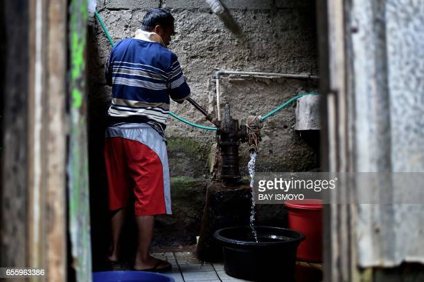 A man pumps freshwater from the ground at a public toilet in Jakarta on March 21 on the eve of World Water Day International World Water Day is...