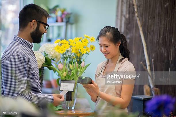 Man Purchasing Flowers