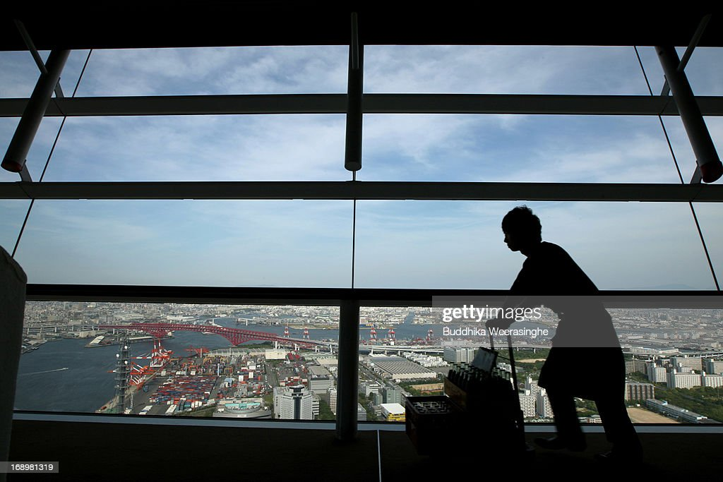 A man pushes a cart at Prefectural Government Observation deck on May 17, 2013 in Osaka, Japan. Japan's economy recently shows the sign of recovery as the growth of last quarter was 0.9 percent, or 3.5 percent on annual basis.