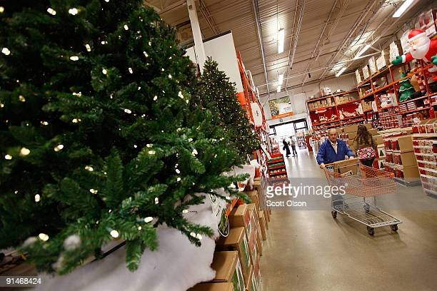 A man pushes a store cart near Christmas merchandise offered for sale at a Home Depot store October 5 2009 in Niles Illinois Analysts are predicting...