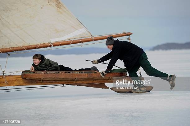 A man pushes an ice boat as he sails on a frozen Hudson River March 7 2014 in Barrytown New York These historic 'ice yachts' some dating to the late...