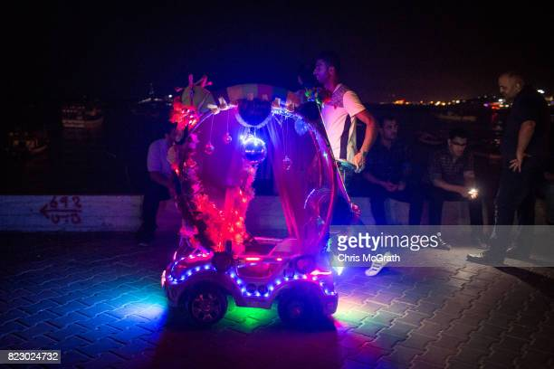 A man pushes around a childrens ride at the Gaza port on July 20 2017 in Gaza City Gaza For the past ten years Gaza residents have lived with...