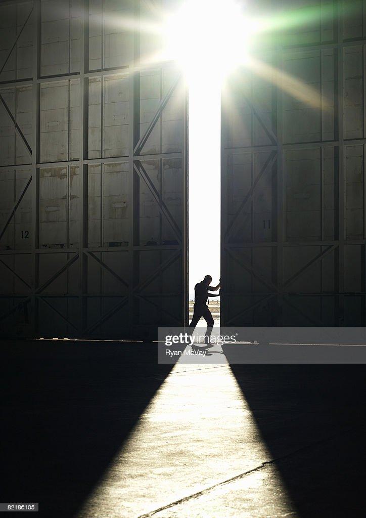 man pushing door open : Stock Photo