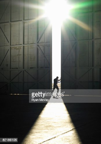 man pushing door open : Stock Photo