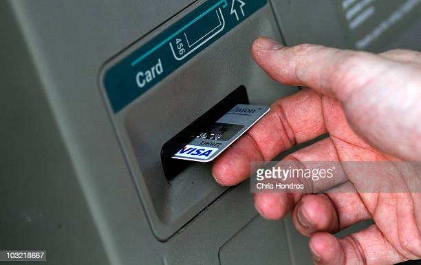A man puts a card into an ATM August 3 2010 in Fayetteville North Carolina A US government report issued August 3 gave evidence that the economic...