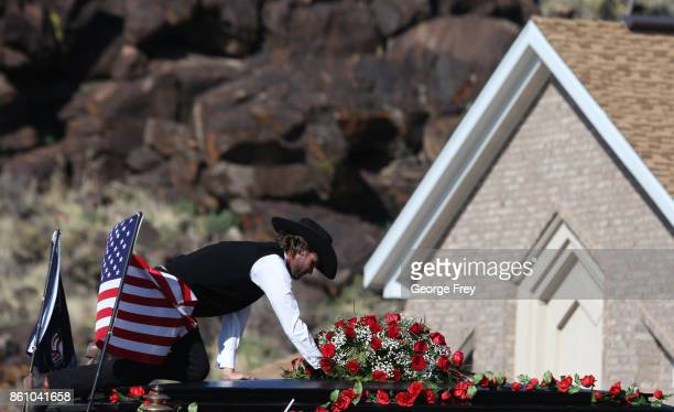 A man puts flowers on top of a horse drawn hurst carrying the casket of Heather Lorraine Alvarado after her funeral services on October 13 2017 in...