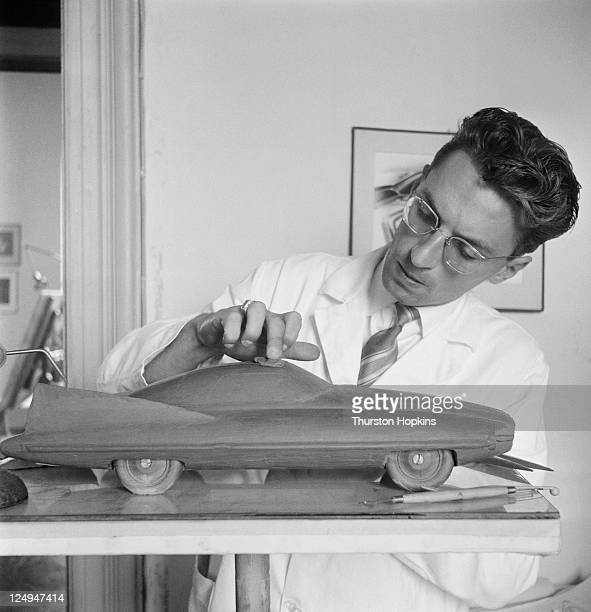 A man puts the finishing touches to a clay model of a new prototype car in Italy 28th September 1956 Original Publication Picture Post 8703 Fashion...