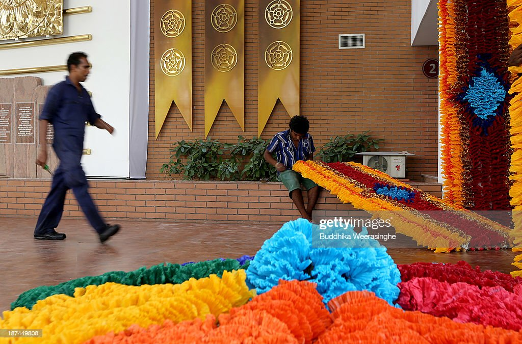 A man puts the finishing touches to decorations ahead of the Commonwealth Heads of Government Meeting (CHOGM) on November 9, 2013 in Colombo, Sri Lanka. The bi-annual gathering of Commonwealth leaders will take place in the Sri Lankan captial, Columbo, November 15-17. CHOGM will move forward despite some human rights groups urging leaders to boycott the meetings until Sri Lanka further investigates charges of war crimes. Canadian Prime Minister, Stephen Harper has already confirmed he will not attend.