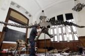 A man puts together a Diplodocus dinosaur skeleton inside the 'Institut de Paléontologie Humaine' ahead of the 'Tresors de dinosaures' exhibition on...