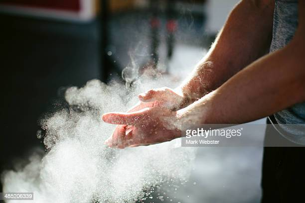 Man putting chalk on his hands