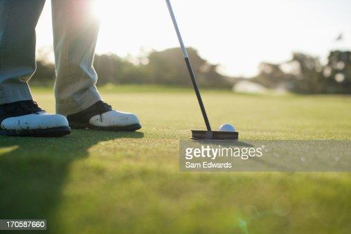 Man putting golf ball