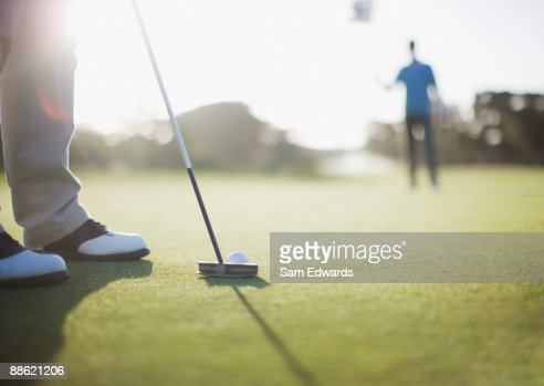 Man putting golf ball : Stock Photo