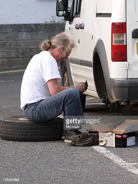 Man putting new brake pads on his car