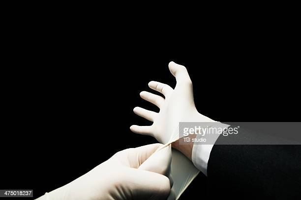 Man Putting On Latex Gloves