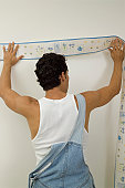 Man putting up wall paper