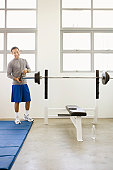 Man putting weight in barbell