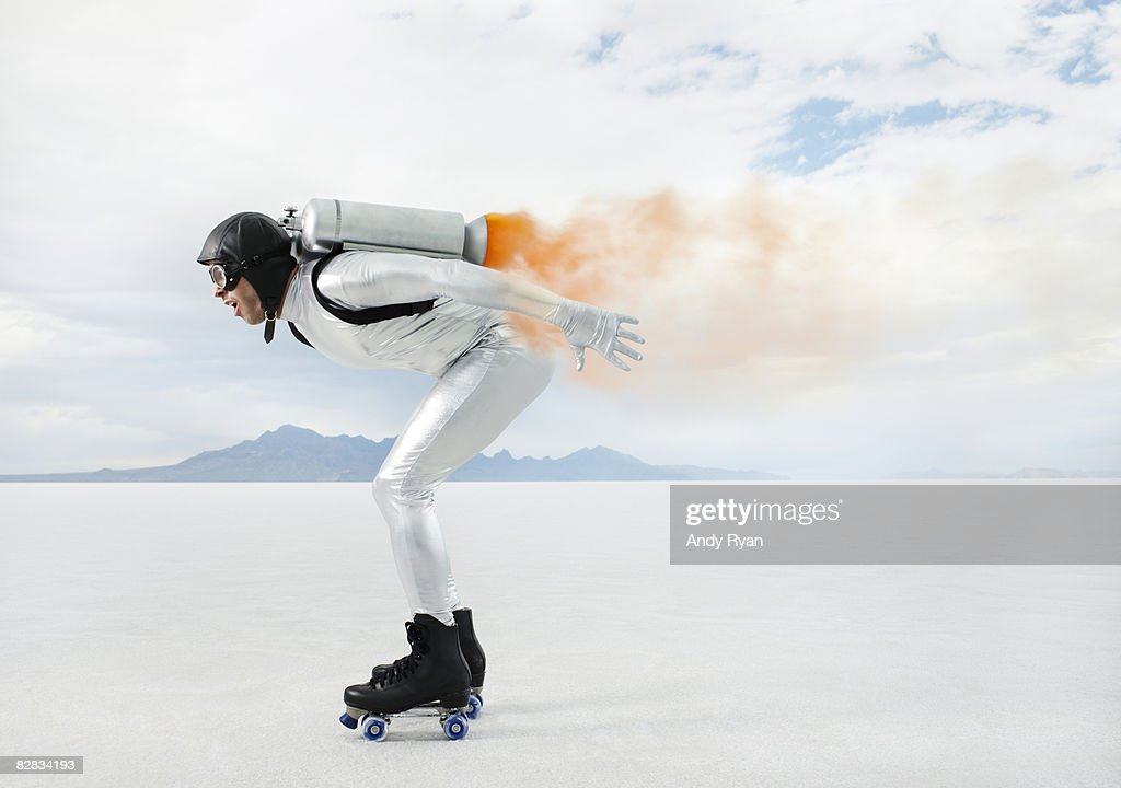 Man Racing Wearing Jetpack and Rollerskates.