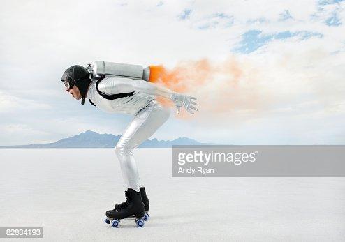 Man Racing Wearing Jetpack and Rollerskates.