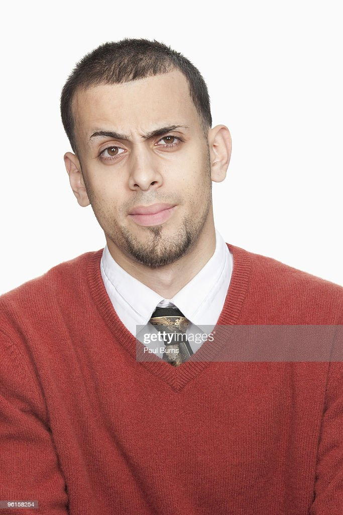 Man raising brow : Stock Photo
