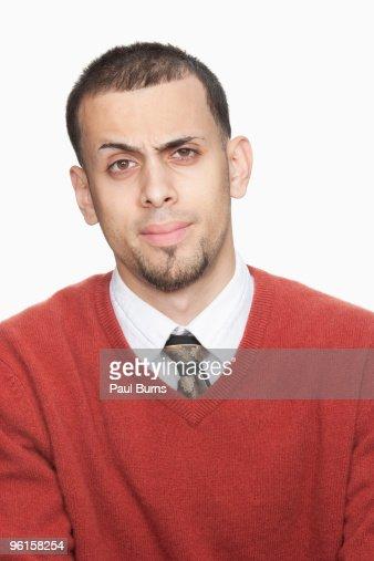 Man raising brow : Stock Photo