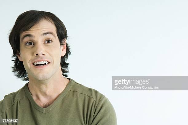Man raising eyebrows, smiling, portrait