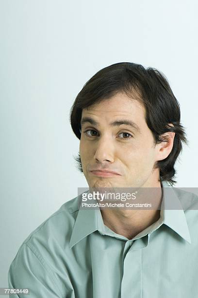 Man raising eyebrows, wrinkling chin, portrait
