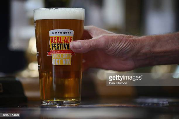 A man reaches for a glass of Ale at the CAMRA Great British Beer festival at Olympia London exhibition centre on August 12 2015 in London England The...
