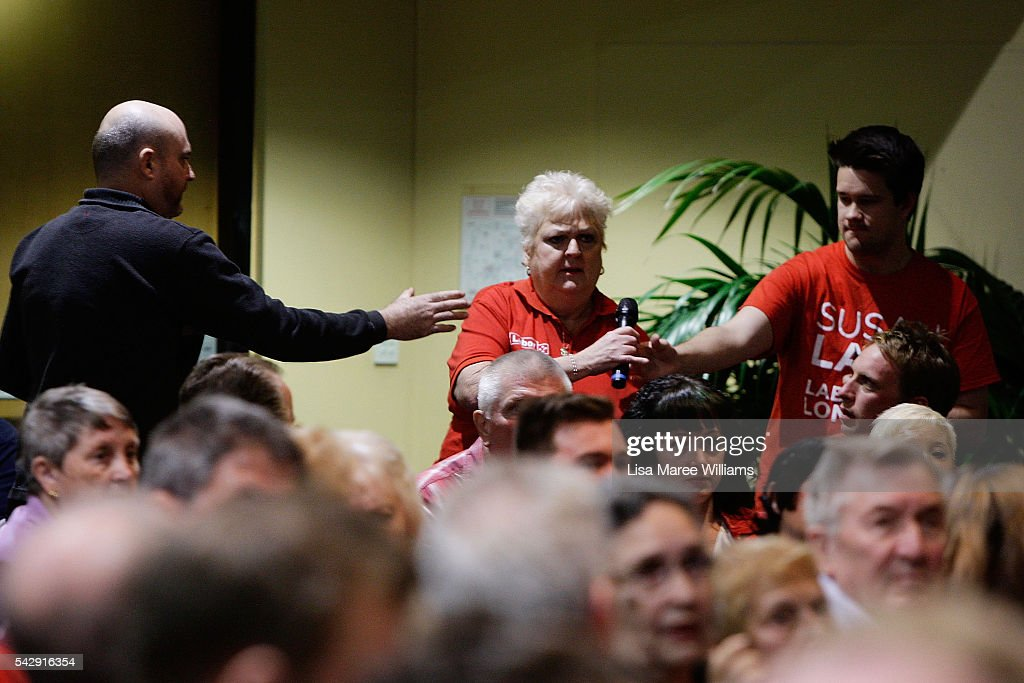 A man reaches for the microphone as Pauline Freeman asks the Opposition Leader Bill Shorten a question during his visit to the Caboolture RSL on June 25, 2016 in Caboolture, Australia. Bill Shorten launched his positive policies for Queensland including a overhaul of the visa system and continues to campaign heavily on Medicare, promising to make sure it isn't privatised if the Labor Party wins the Federal Election on July 2.