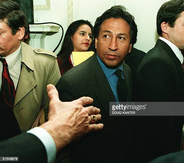 A man reaches out to shake hands with Peruvian presidential candidate Alejandro Toledo after his address at the Americas Society in New York 27 April...