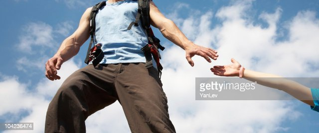 Man reaches out to women : Stock Photo