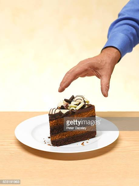 Man reaching for cake