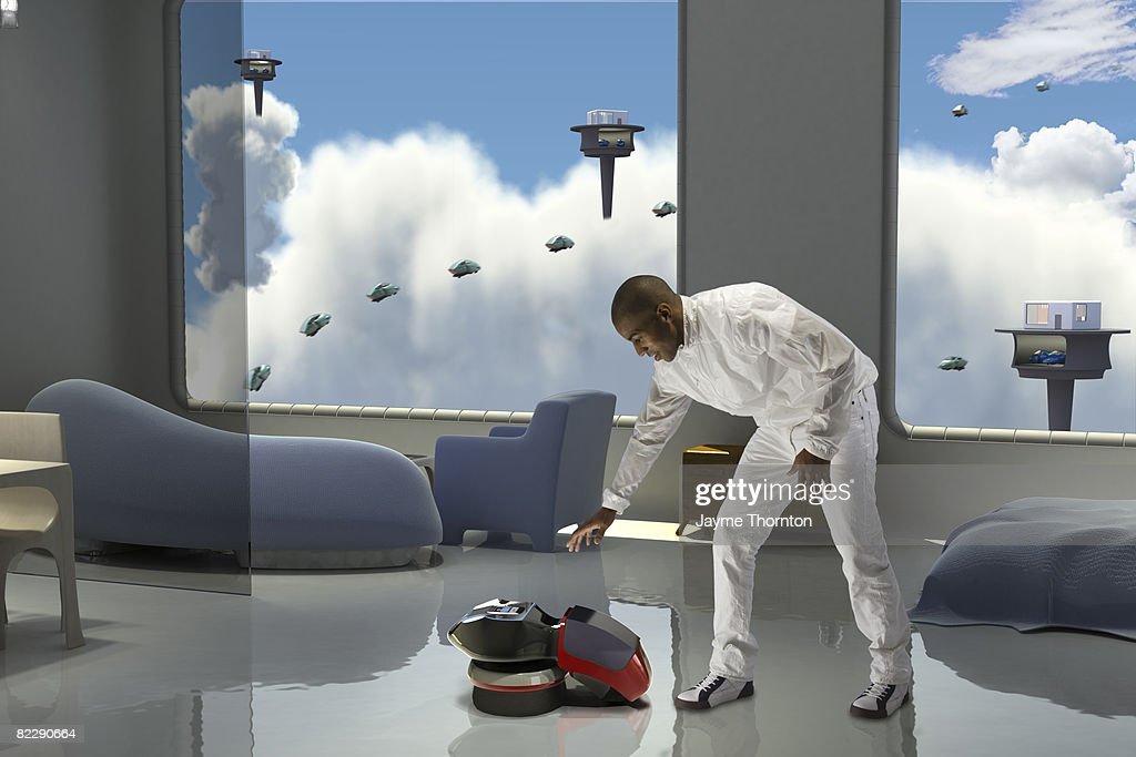 Man reaching for robot in future home : Stock Photo