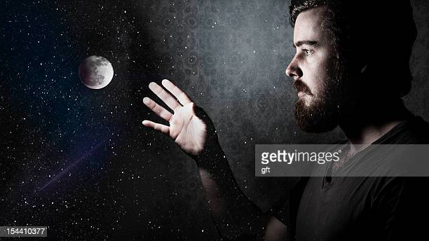Man reaching moon.