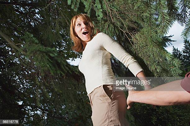Man reaching to touch woman's bottom