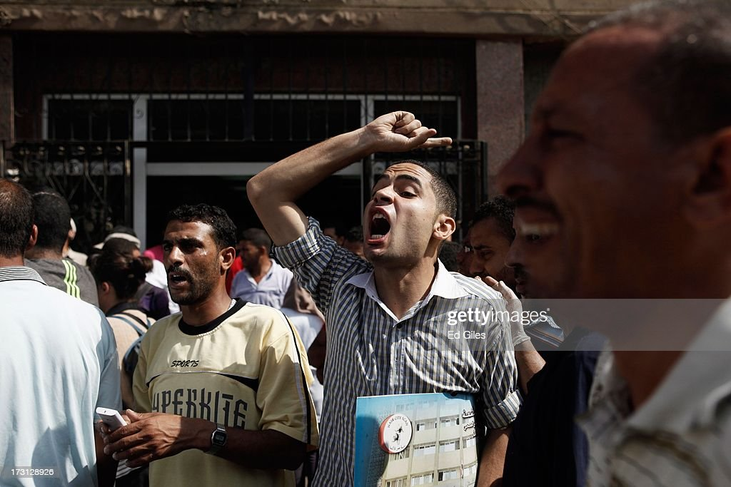 A man reacts after seeing the body of a slain protester at the Liltaqmeen al-Sahy Hospital in Cairo's Nasr City district, allegedly killed during a shooting at the site of a pro-Morsi sit-in in front of the headquarters of the Egyptian Republican Guard on July 8, 2013 in Cairo, Egypt. Egyptian health ministry officials are reporting at least 42 people were killed and more than 300 injured in the incident early on Monday morning, which allegedly occurred as supporters of deposed Egyptian President Mohammed Morsi attending the sit in were performing dawn prayer. The demonstrators were demanding the release of Morsi, who they believe is being held inside the Republican Guard headquarters.
