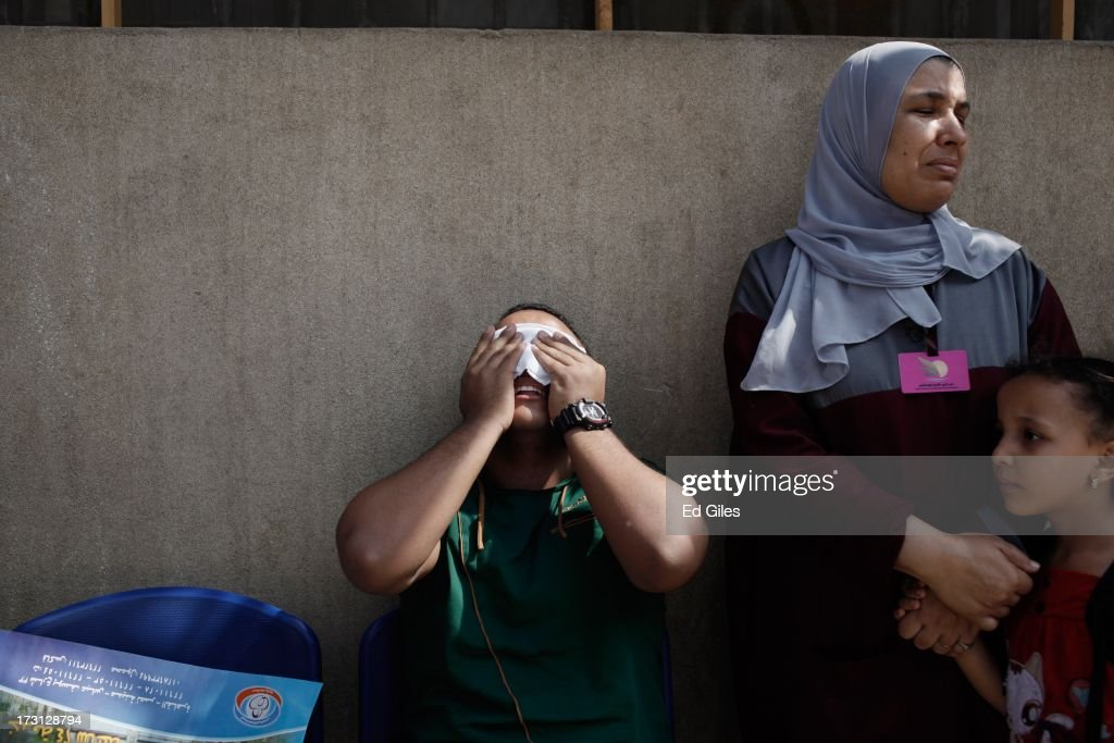 A man reacts alongside a woman and child after seeing the body of a family member, allegedly killed during a shooting at the site of a pro-Morsi sit-in in front of the headquarters of the Egyptian Republican Guard, at the Liltaqmeen al-Sahy Hospital in Cairo's Nasr City district on July 8, 2013 in Cairo, Egypt. Egyptian health ministry officials are reporting at least 42 people were killed and more than 300 injured in the incident early on Monday morning, which allegedly occurred as supporters of deposed Egyptian President Mohammed Morsi attending the sit in were performing dawn prayer. The demonstrators were demanding the release of Morsi, who they believe is being held inside the Republican Guard headquarters.