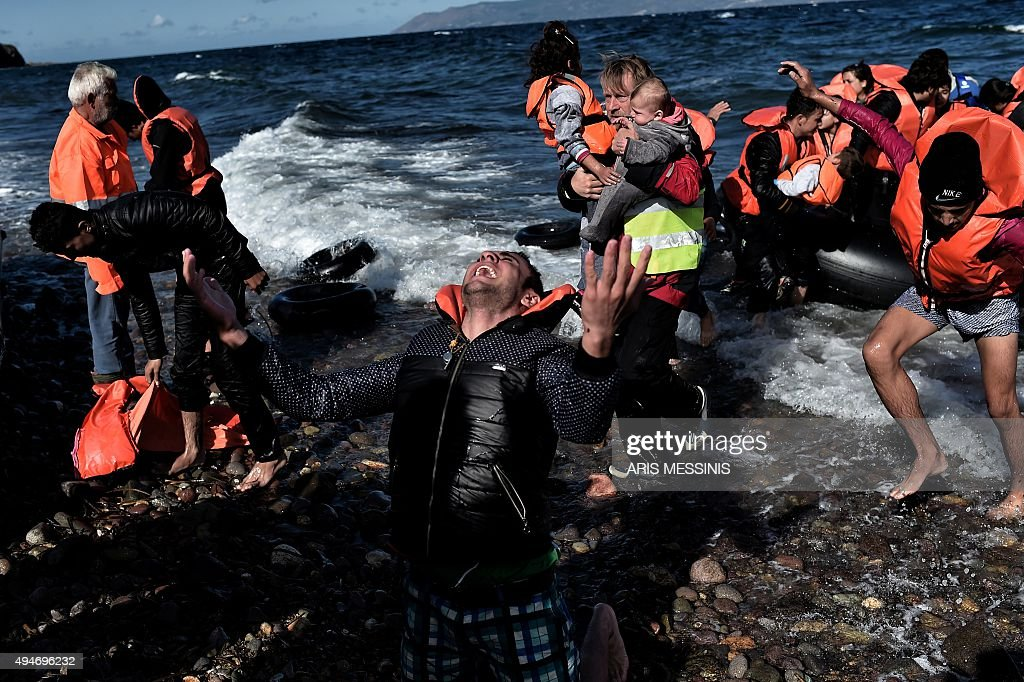 A man reacts as he arrives with other refugees and migrants on the Greek island of Lesbos on October 28 after crossing the Aegean sea from Turkey At...