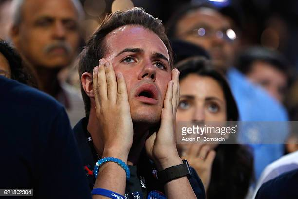 A man reacts as he watches voting results at Democratic presidential nominee former Secretary of State Hillary Clinton's election night event at the...