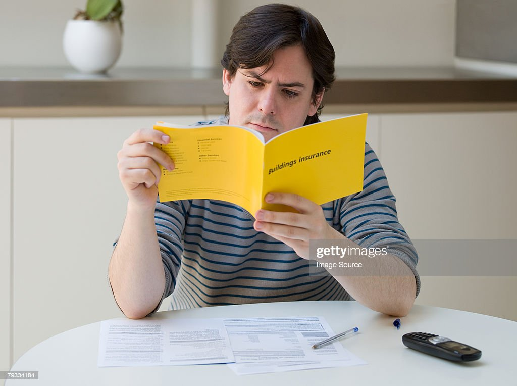 A man reading an insurance leaflet