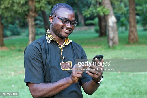 Man reading an sms on his mobilephone