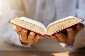 A man  Reading  bible.