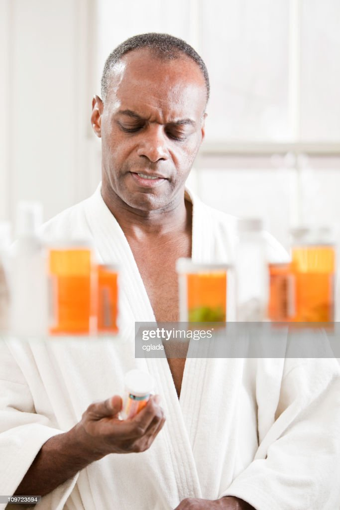 Man Reading Drug Label : Stock Photo