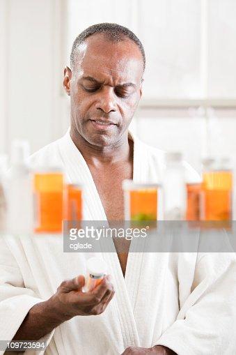 Man Reading Drug Label : Stock Photo