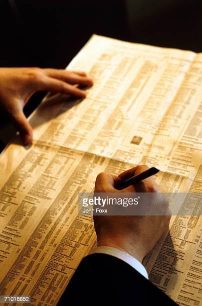 Man reading financial newspaper